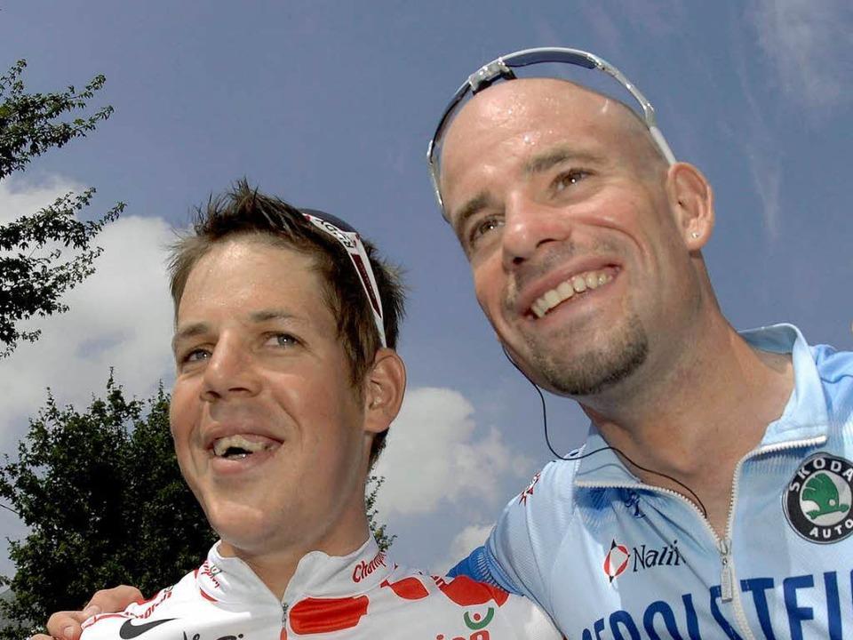 Bernhard Kohl und Stefan Schumacher: B... Tour de France 2008 lachten sie noch.    Foto: dpa
