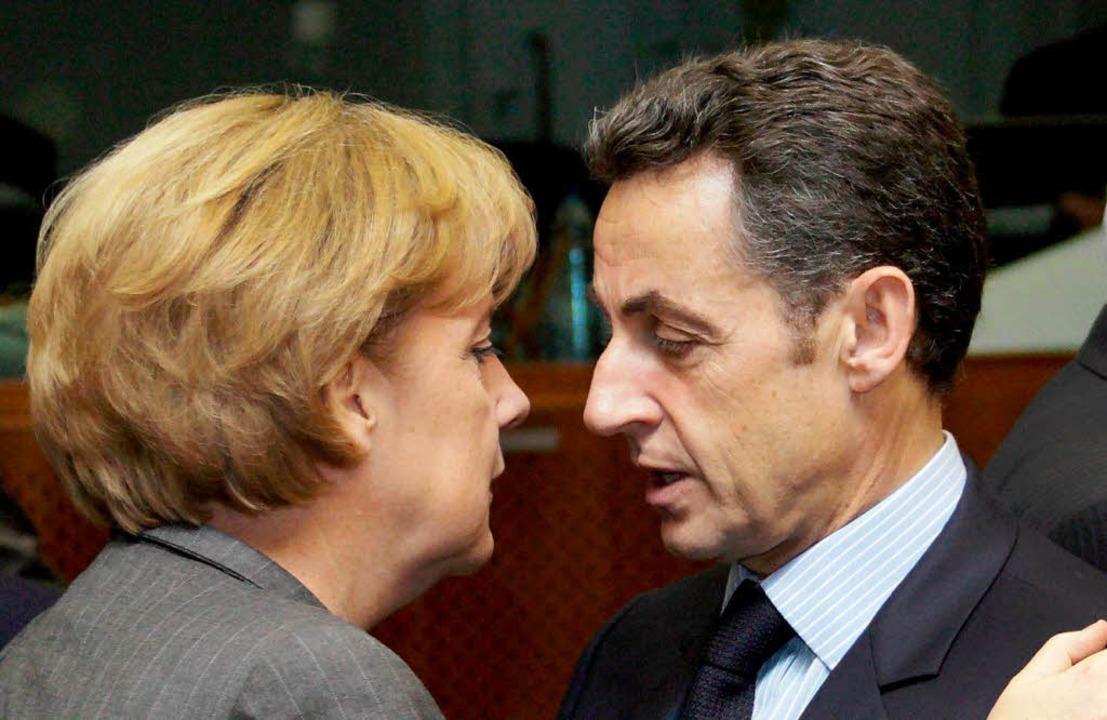 Angela Merkel und Nicolas Sarkozy: Bis...m Details des EU-Konjunkturprogramms.   | Foto: dpa