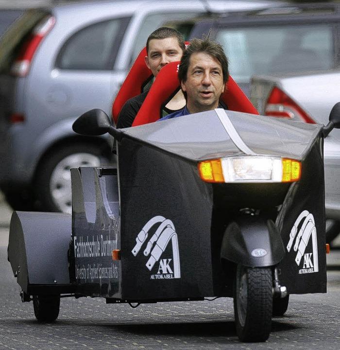 Dreirad mit Radnabenmotoren: das zweis...n Studenten aus Dortmund konstruiert.   | Foto: dpa