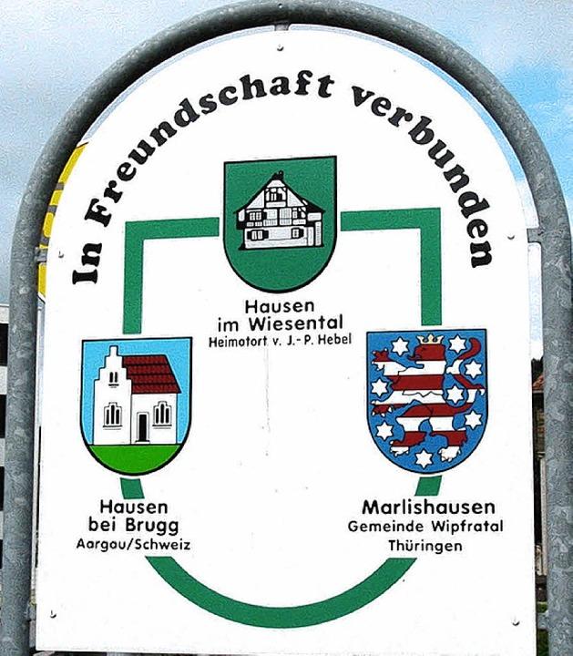 Die Gemeindewappen der Partnergemeinden Hausen.   | Foto: Elmar Vogt