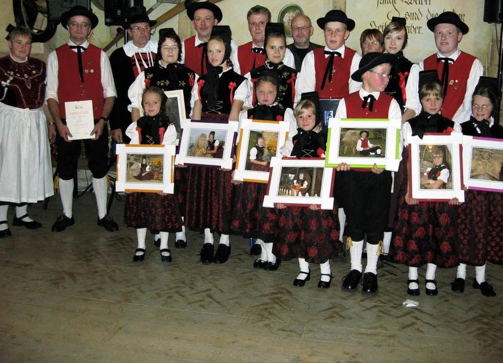 Die Trachtentanzgruppe Amrigschwand-Ti...schaft mit einem Bild belohnt werden.     Foto: Verein