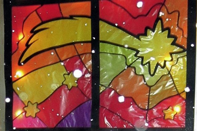 Schneeflocken beim Adventsfenster