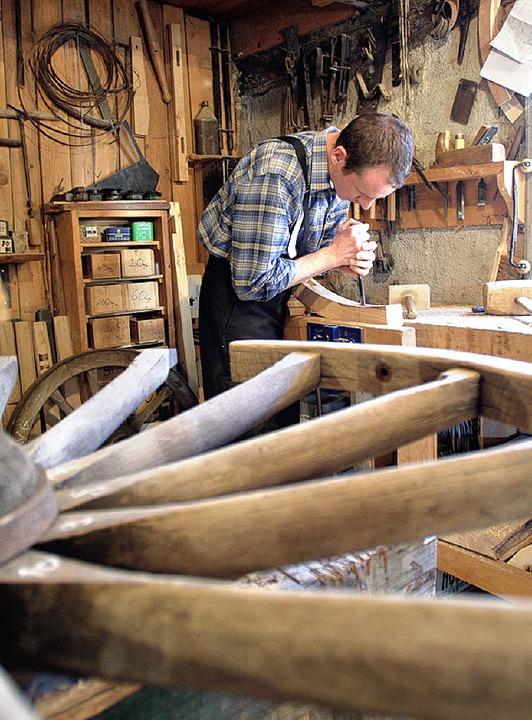Handwerker zeigen das Leben von einst.    Foto: Ecomusee Elsass