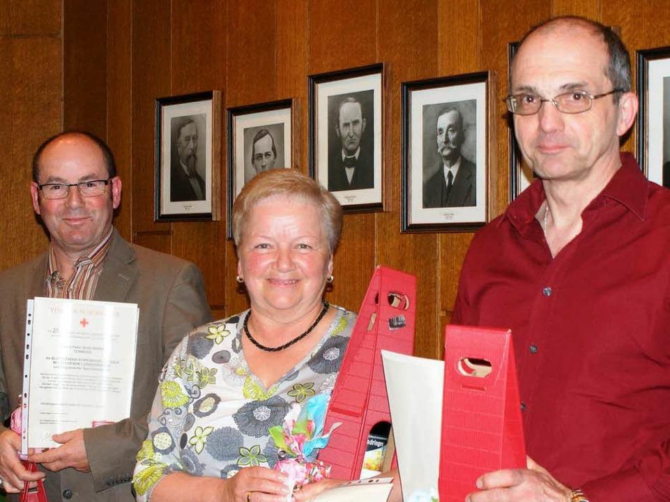 Peter Bahlinger, Rosmarie Flösch und Hansjörg Nutto werden geehrt.  | Foto: hans-jürgen truöl
