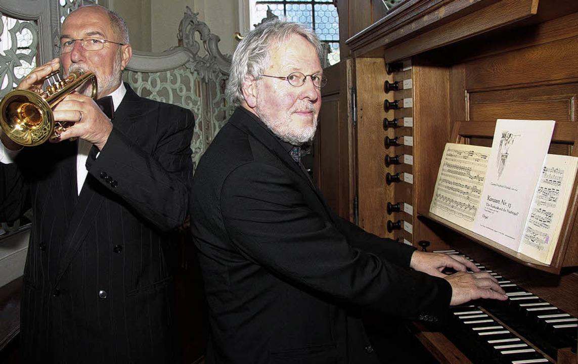 Claude Rippas (Trompete) und Friedrich Fröschle boten festliche Musik.     Foto: sandra decoux-kone