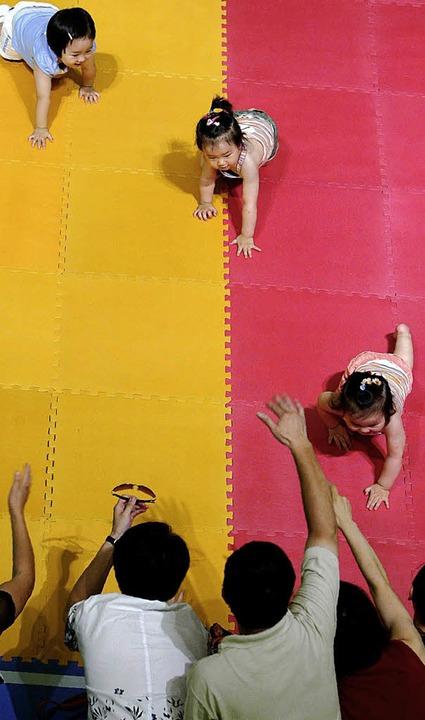 Unsinniger Wettlauf: Jedes Kind hat sein eigenes Tempo.   | Foto: AFP/BZ