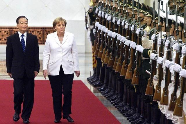 Außergewöhnliche Geste für Merkel