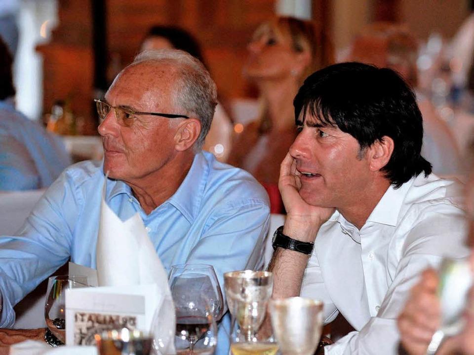 Der ehemalige Bundestrainer Franz Beck...mtierende DFB-Cheftrainer Jaachim Löw.  | Foto: ddp
