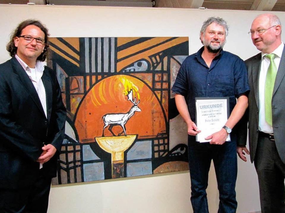 Hartmut Schölch, Peter Schütz und Clau...ks) während der Ausstellungseröffnung.  | Foto: Susanne Filz