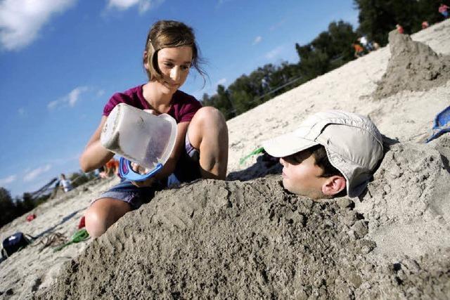Kunst am Mensch mit Sand vom Strand