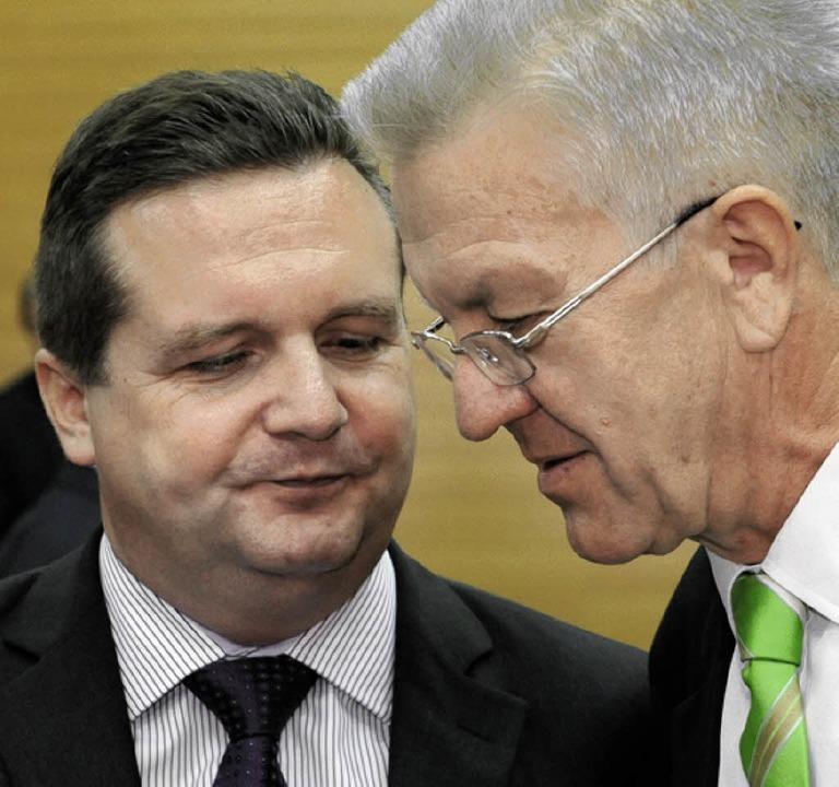 Stefan Mappus (links) und Winfried Kretschmann   | Foto: dpa