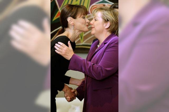 Merkel macht Politik mit Carla Bruni-Sarkozy