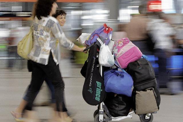 Kofferpacken mit der Küchenwaage