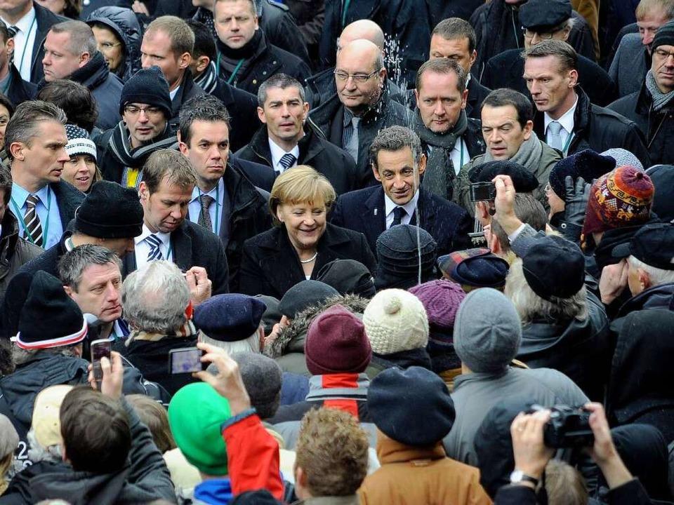 Geht diese Szene als Freiburger Spritz...tzt mit Wasser auf Merkel und Sarkozy.  | Foto: Thomas Kunz
