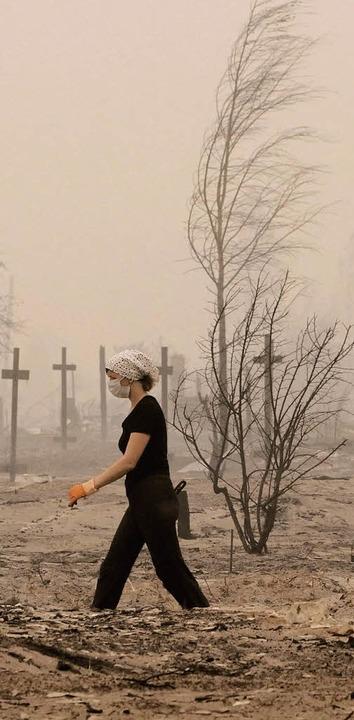 Verheerende Waldbrände infolge der Tro...auch Moskau,  in einen düsteren Nebel.  | Foto: DPA