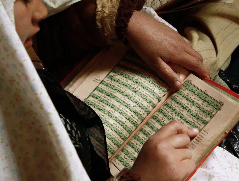 Der Koran, für Nichtmoslems ein Buch mit sieben Siegeln.    | Foto: DPA