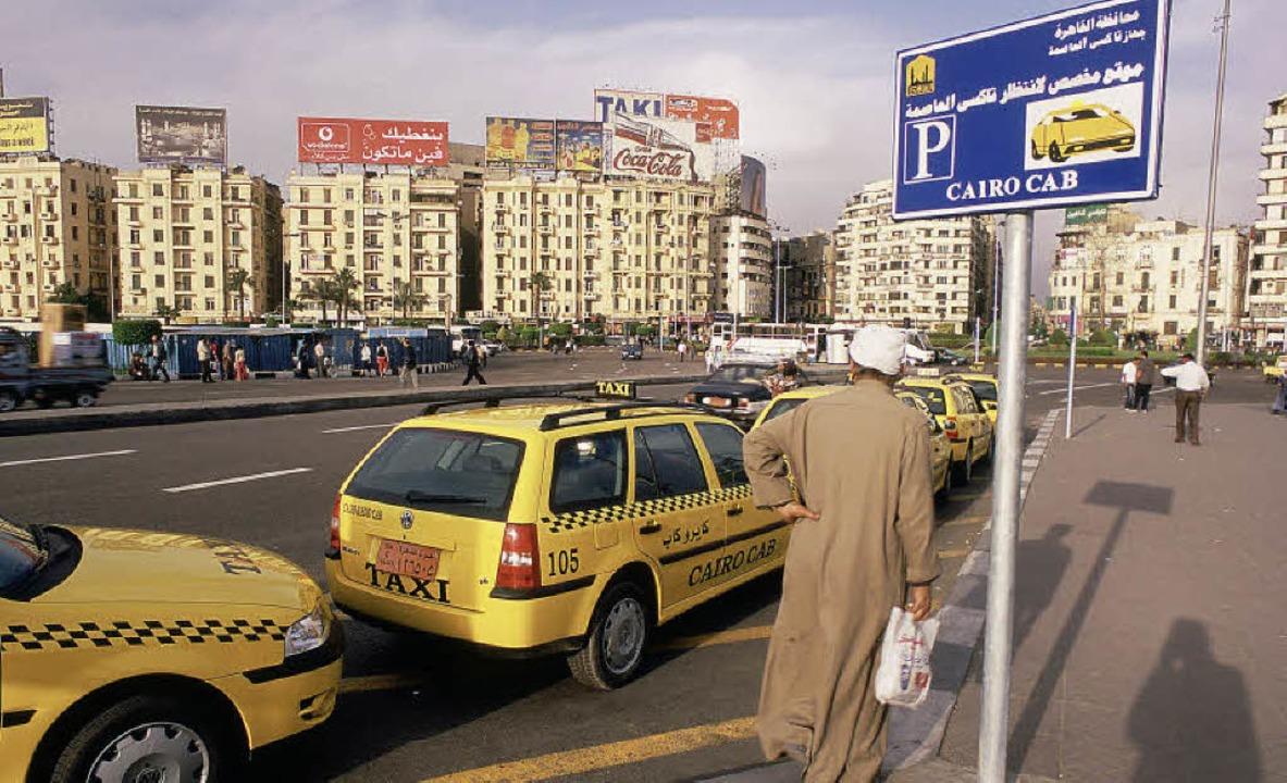 Neue Taxen auf dem Tahrir-Platz in Kairo    Foto: dpa