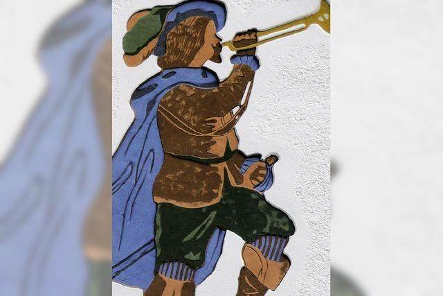 Ein Trompeter auf der Fassade