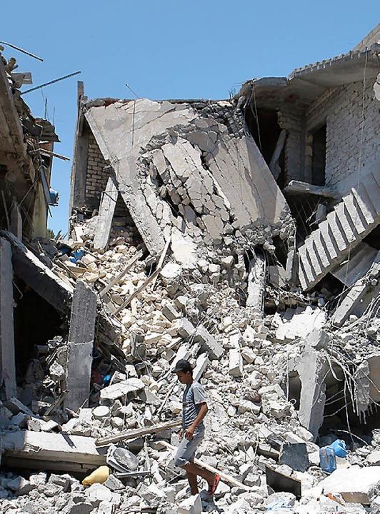 Zerstörtes Haus in Tripolis   | Foto: DPA