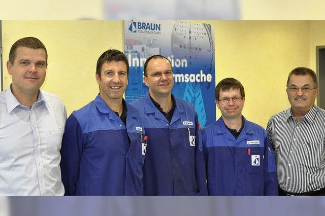 Drei Stützen der Firma