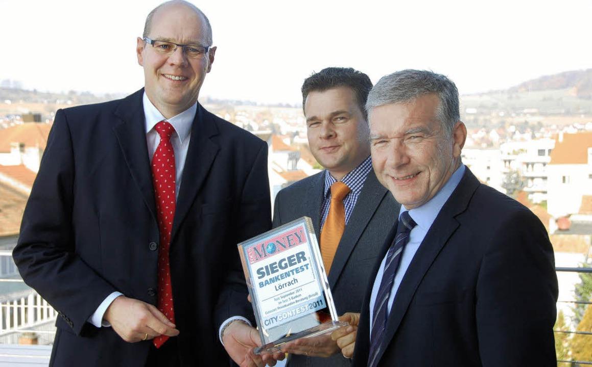 """Vorstand Ulf Bleckmann, Kai Fürderer v...#8222;Focus Money City Contest""""     Foto: Willi Adam"""