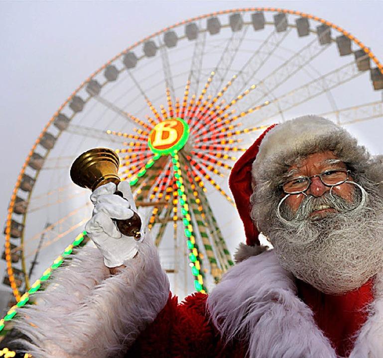 Zwei Attraktionen: Riesenrad und Santa Claus  | Foto: dpa