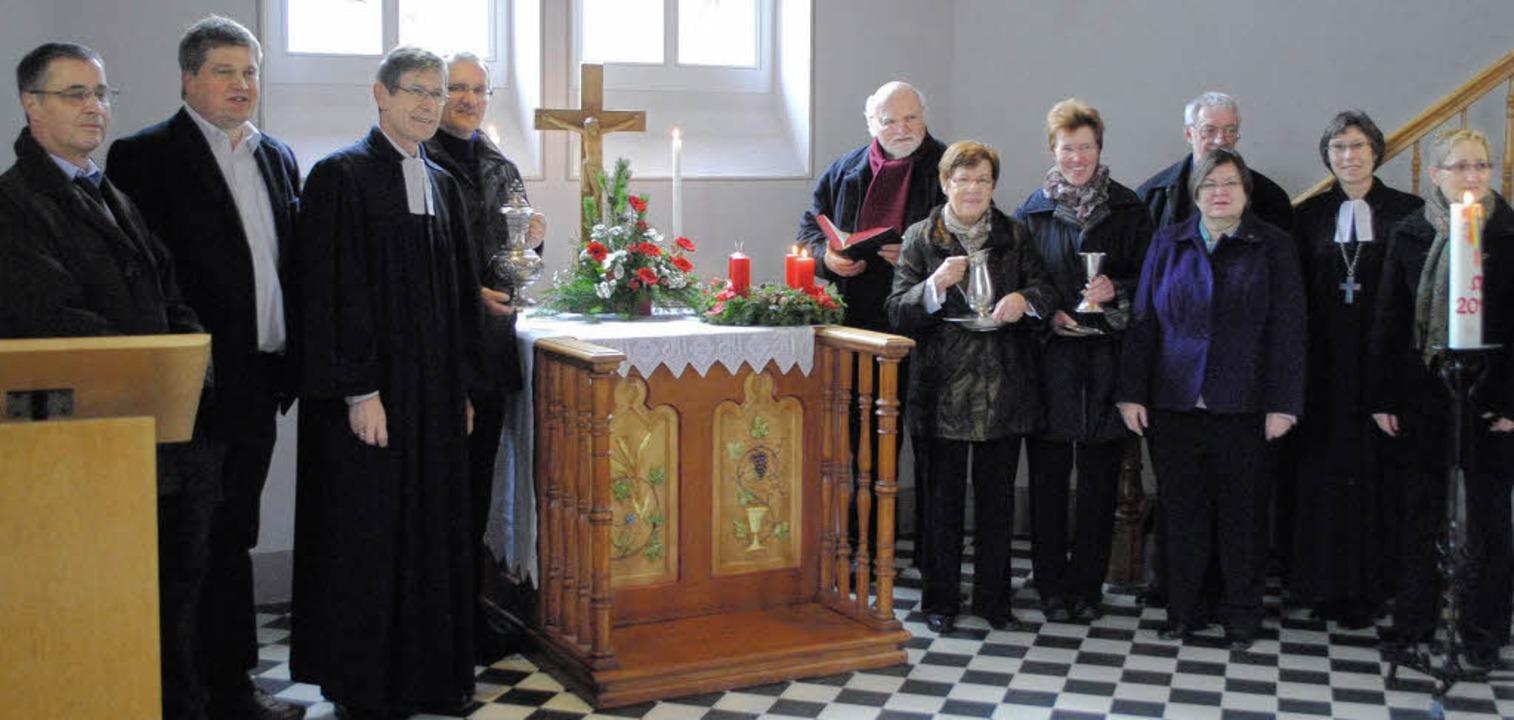 Mitglieder des Kirchengemeinderats Bad...r in der Martinskirche in Niederweiler  | Foto: Beatrice Ehrlich