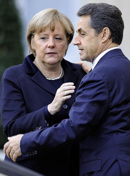 Wollen die Eurozone reformieren: Merkel und Sarkozy   | Foto: AFP