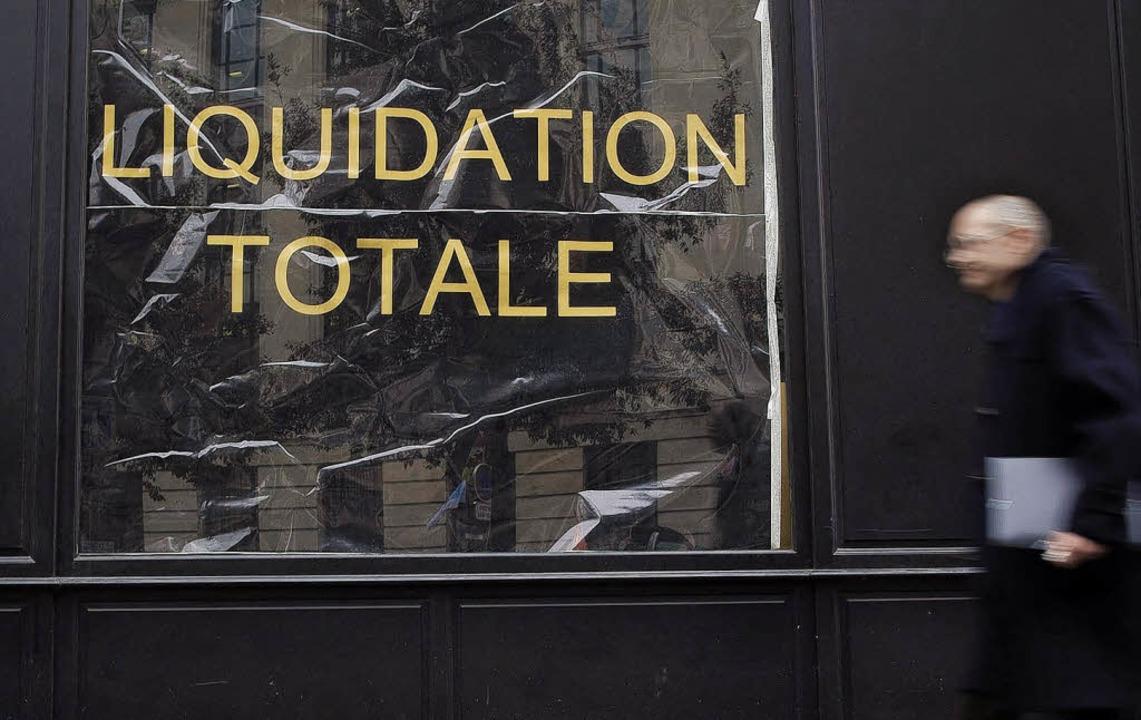 Schlechtes Omen für den Eurogipfel? Dieses Geschäft in Paris gibt auf.   | Foto: dpa
