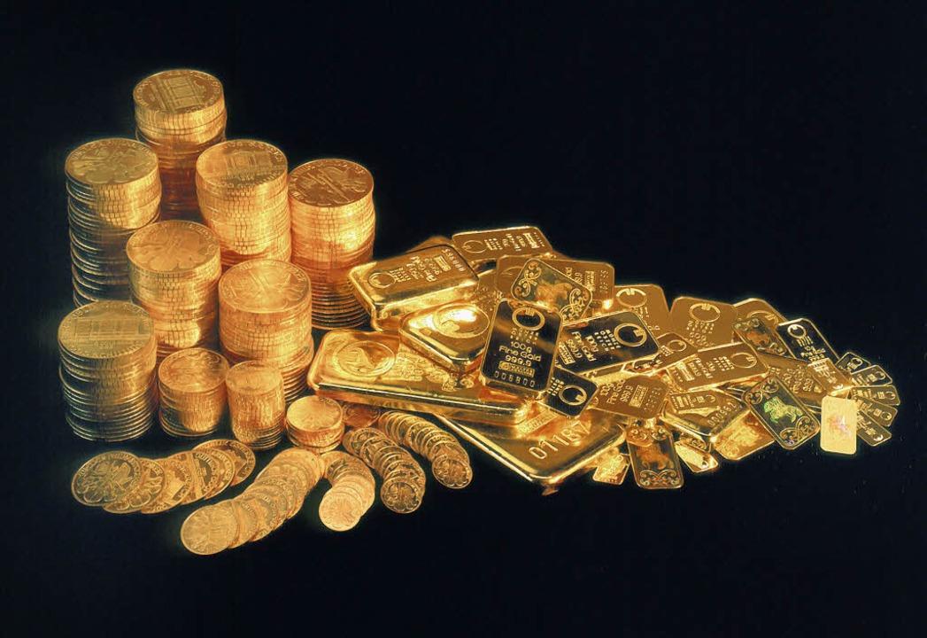 Krisengewinner: güldene Münzen und Barren     Foto: dpa