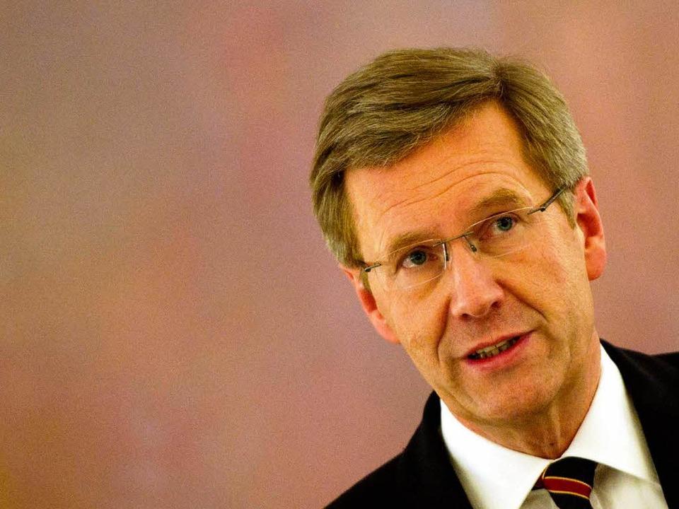 Nur noch eine knappe Mehrheit  der Deu... sein Staatsoberhaupt Christian Wulff.    Foto: AFP