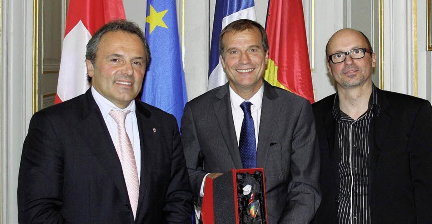 Eric Jakob, Klaus Eberhardt und Slow-u...sverleihung in Straßburg (von links).     Foto: BZ