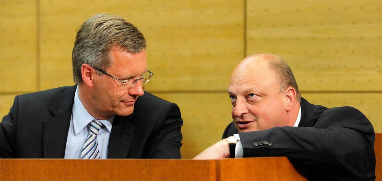 Christian Wulff und sein ehemaliger Berater Olaf Glaeseker.  | Foto: dpa