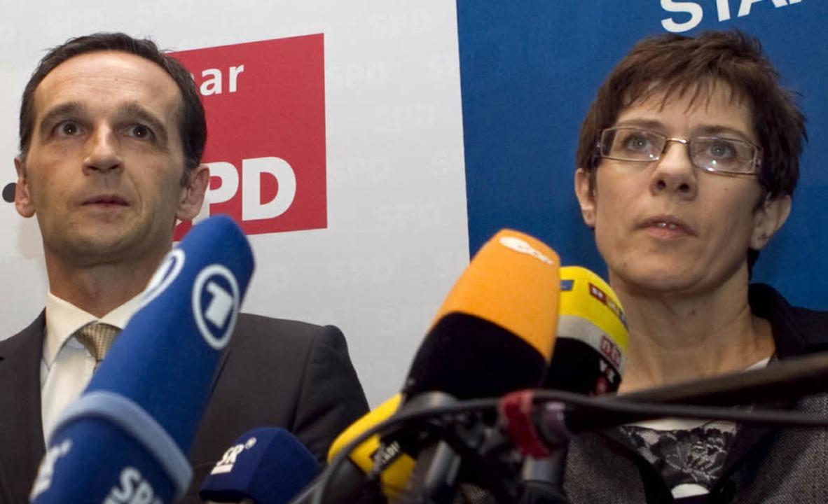 Heiko Maas, Landesvorsitzender der SPD...ntin Annegret Kramp-Karrenbauer (CDU).  | Foto: dapd