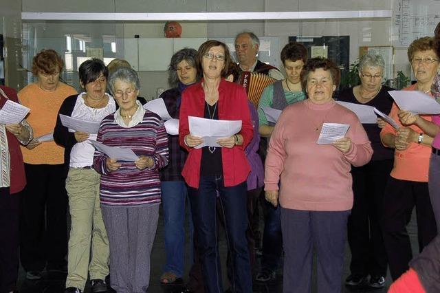 Besucher mit Volksliedern empfangen