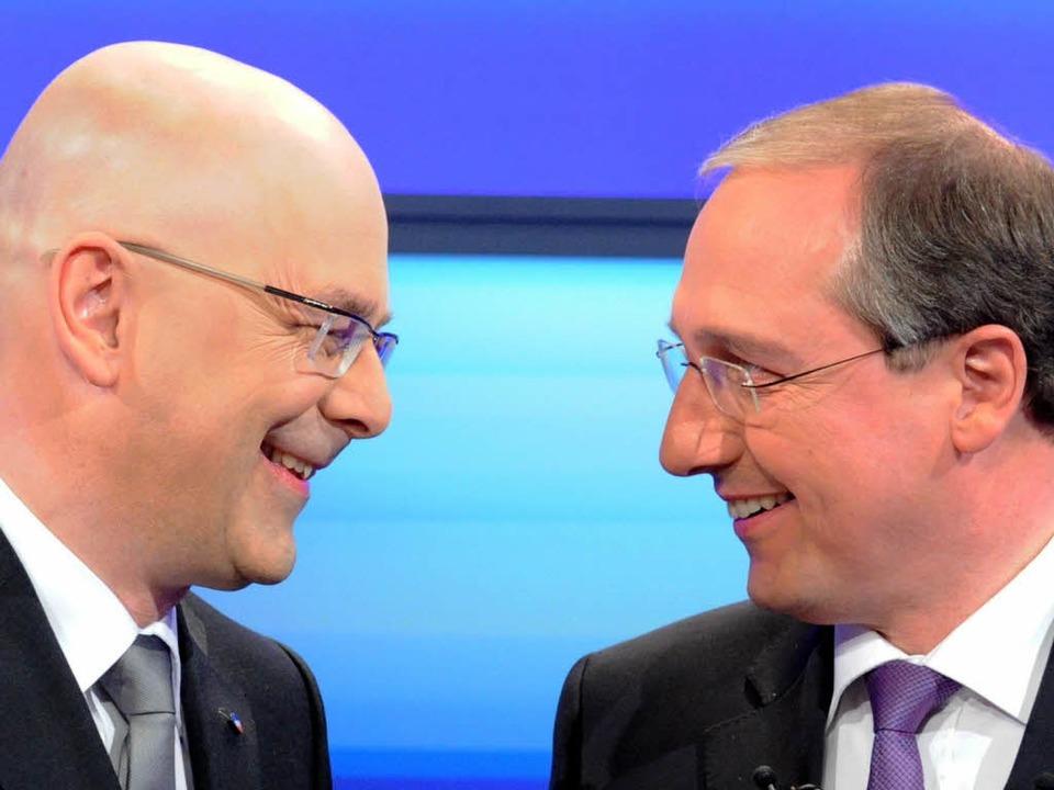 Kopf an Kopf: Die Spitzenkandidaten Jo...(CDU, rechts) und Torsten Albig (SPD).  | Foto: dpa