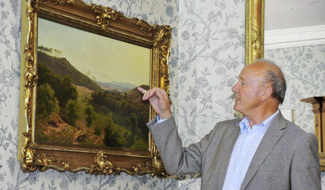 Der Müllheimer Kunsthändler Gottfried ...utert das Gemälde von Karl Eckermann.   | Foto: Volker Münch
