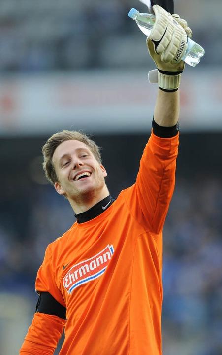 Oliver Baumann steht auch in der kommenden Saison im Tor des SC Freiburg.  | Foto: dapd