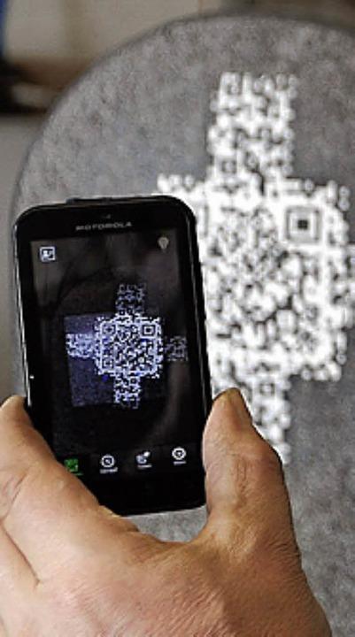 Mit QR-Code: Grab  | Foto:  dpa