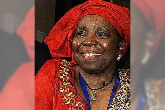 Eine Frau spricht für den schwarzen Kontinent