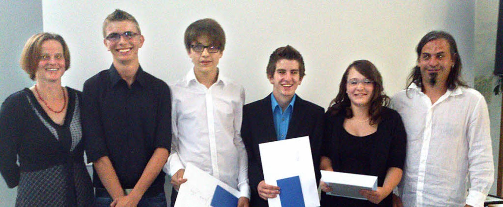 Die Preisträger an der WRS Kippenheim-...ie Donnert und Lehrer Florian Kugler.   | Foto: Michael Masson