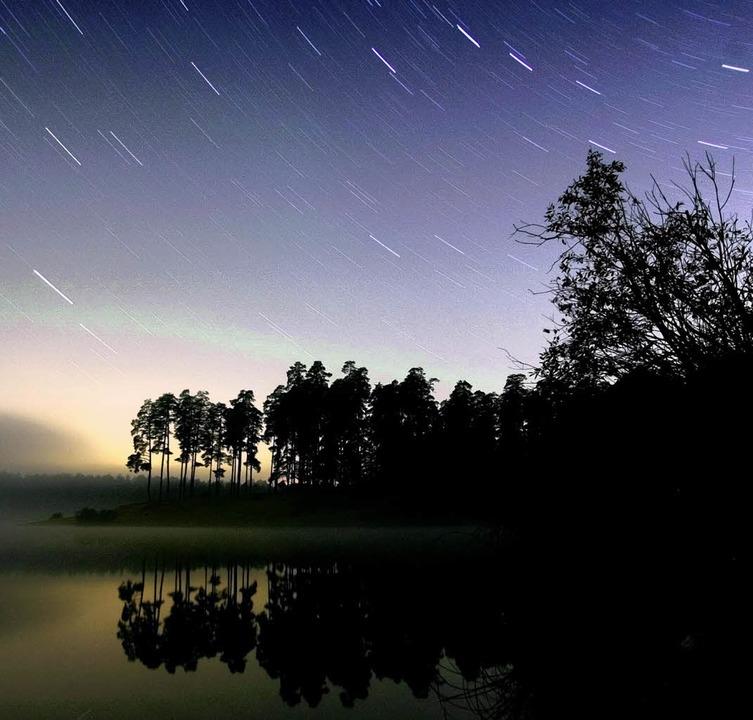 Bewegung am Sternenhimmel ist in den k...arten: Dann regnet es Sternschnuppen.   | Foto: AFP
