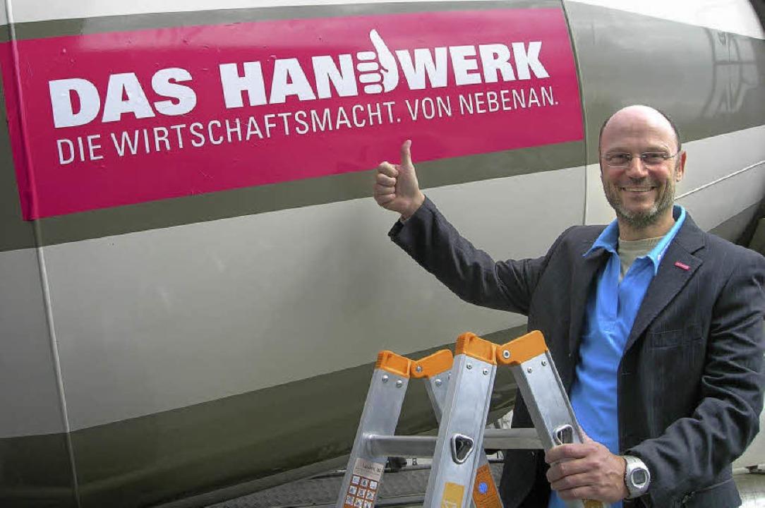 Christof Burger nach dem dem erstmalig...hrzeugs mit dem neuen Handwerks-Slogan  | Foto: Nikolaus Bayer