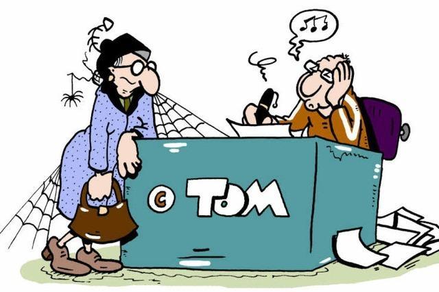BZ-Cartoonist Tom Körner signiert