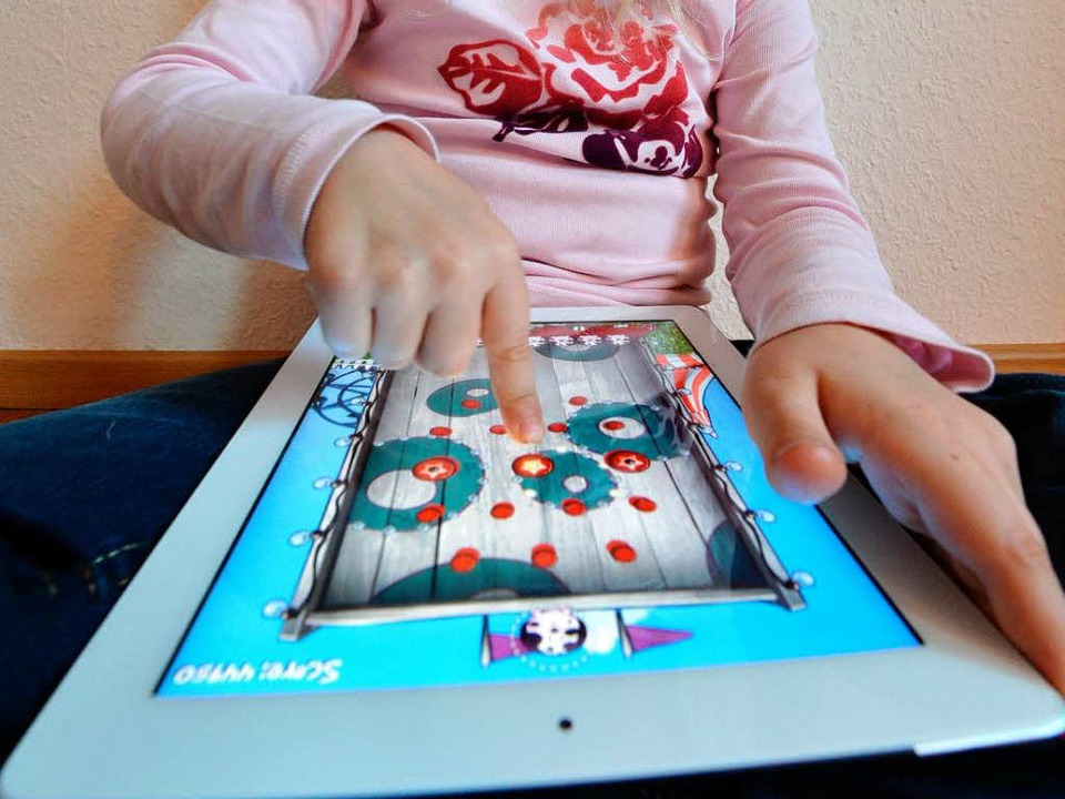 Kinder lieben die Tablets.  | Foto: dapd