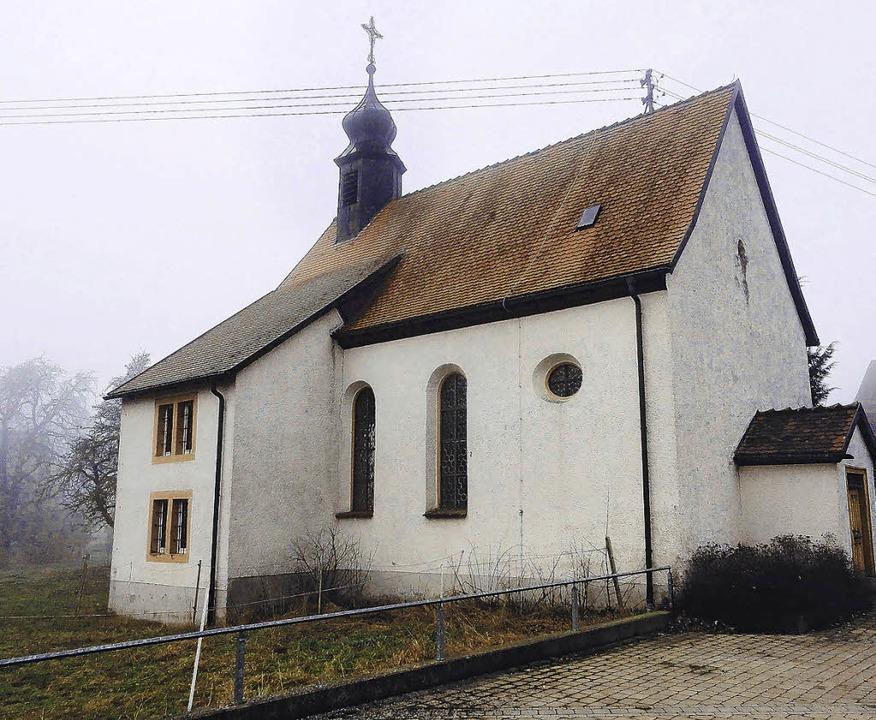 Vom   Winternebel leicht umhüllt: die St. Margarethenkapelle in Mundelfingen  | Foto: Butschle