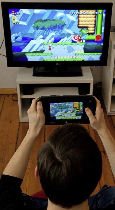 Konsole oder Handheld? Ein Spiel wie &...Wii U theoretisch auch ohne Fernseher.  | Foto: dpa-tmn
