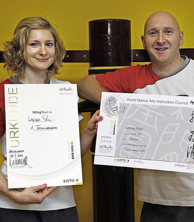 Larissa Pauli und ihr Trainer Roger Hauser   | Foto: Privat