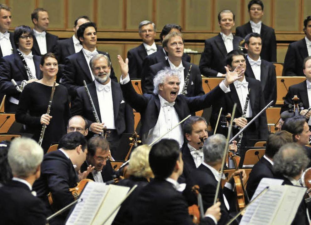 Energieträger: Simon Rattle und die Berliner Philharmoniker   | Foto: dpa