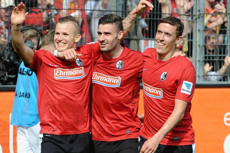 Die SC-Profis Jonathan Schmid, Daniel Caliguri und Max Kruse haben Grund zum Feiern (Foto: Achim Keller)